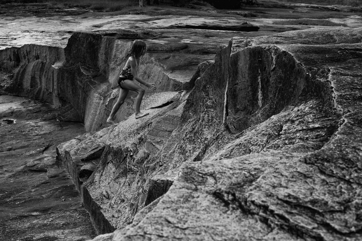 Little Girl Climbing Rocks 1 blog